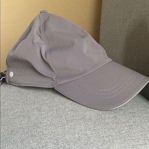 Woman's gray Lululemon dri fit baseball cap.